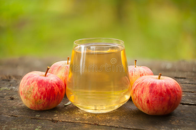 Delicious fresh squeezed apple juice in transparent glass. Delicious fresh squeezed apple juice in a transparent glass stock image