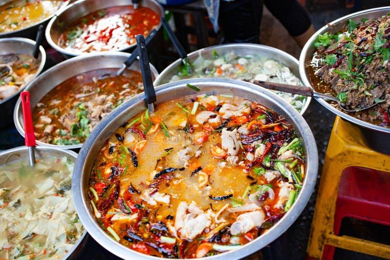 delicious fresh street food in Thailand - top view - Thai Curry, Tamarind, Tom Yam, Shrimp, Pork, Pad Thai royalty free stock photo