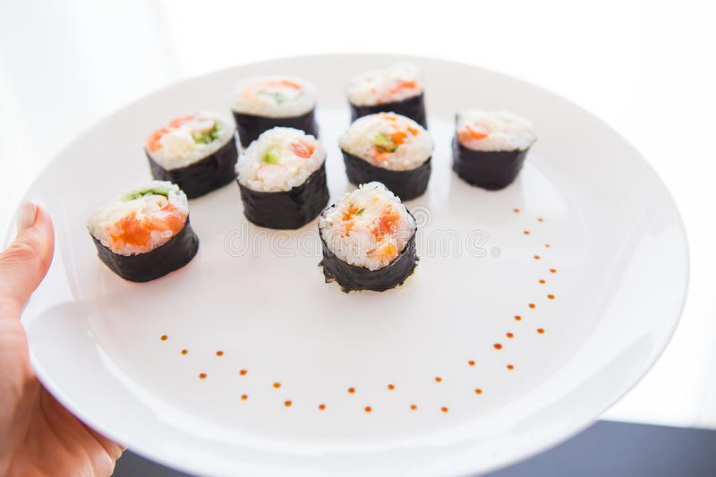 Delicious fresh sushi on a white plate, closeup. View from above stock photography