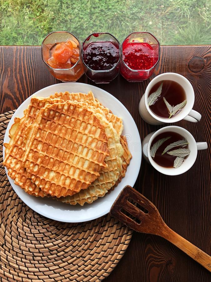 Delicious fresh waffles and jam on the table stock images