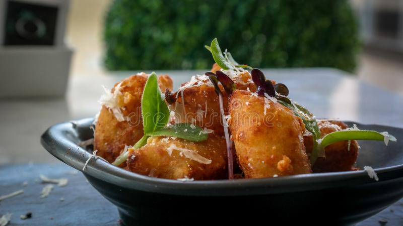 Delicious fried amuse bouche appetizer - Fried food to share stock image