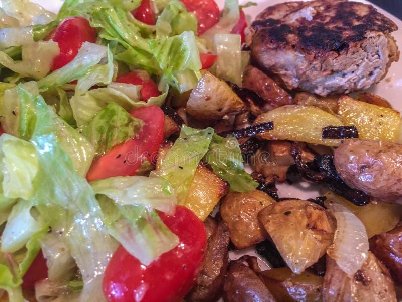 Delicious fried potato, meet and fresh salad royalty free stock photo