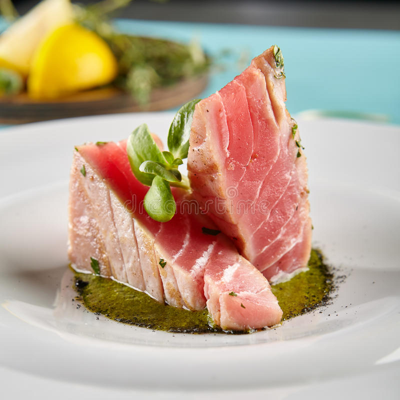 Delicious Fried Tuna Fillet. Restaurant Food - Delicious Fried Tuna Fillet with Sesame outside. Gourmet Restaurant. Delicious Dish stock photography