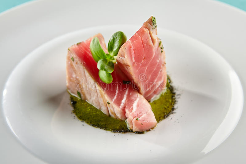 Delicious Fried Tuna Fillet. Restaurant Food - Delicious Fried Tuna Fillet with Sesame outside. Gourmet Restaurant. Delicious Dish royalty free stock photo