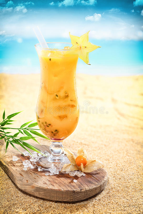 Delicious fruit cocktail on a tropical beach royalty free stock photography