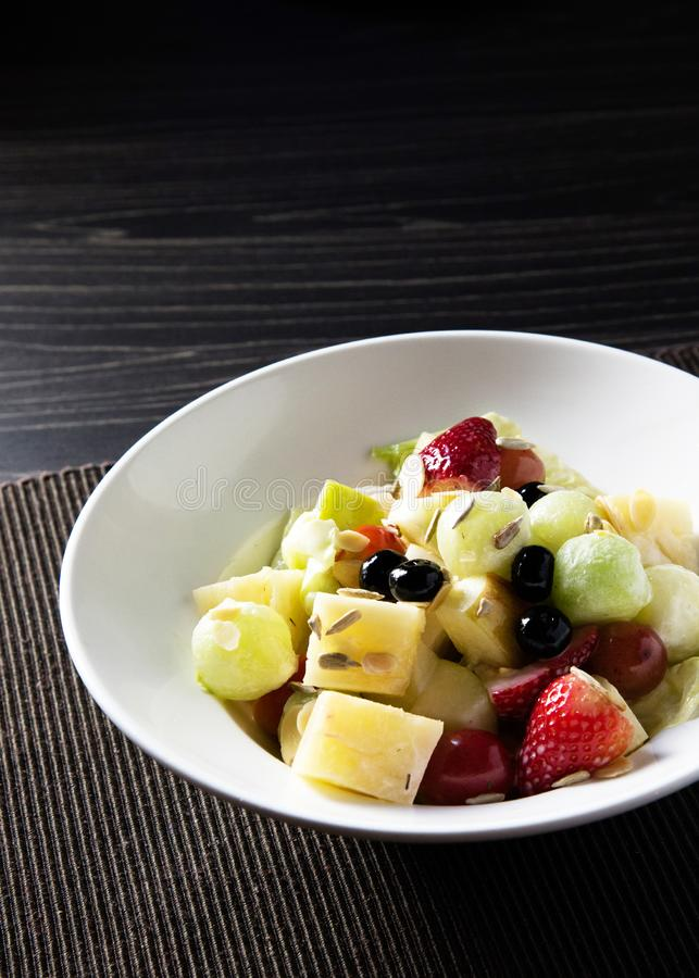 Delicious fruit salad, colorful fruit salad on table stock photos