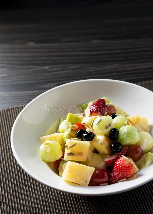 Delicious fruit salad, colorful fruit salad on table stock photo