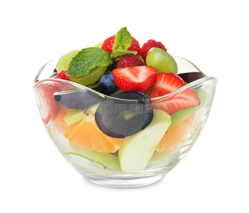 Delicious fruit salad in glass bowl on white background royalty free stock photo