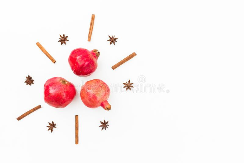 Delicious garnet, cinnamon and anise on white background. New year concept. Flat lay. Top view stock image
