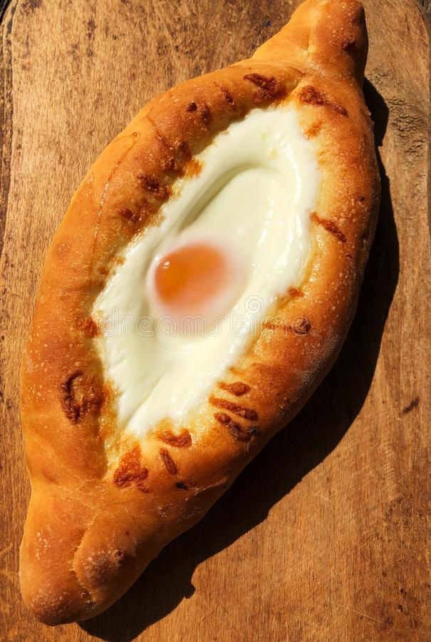 Delicious Georgian bread with egg and cheese stock image