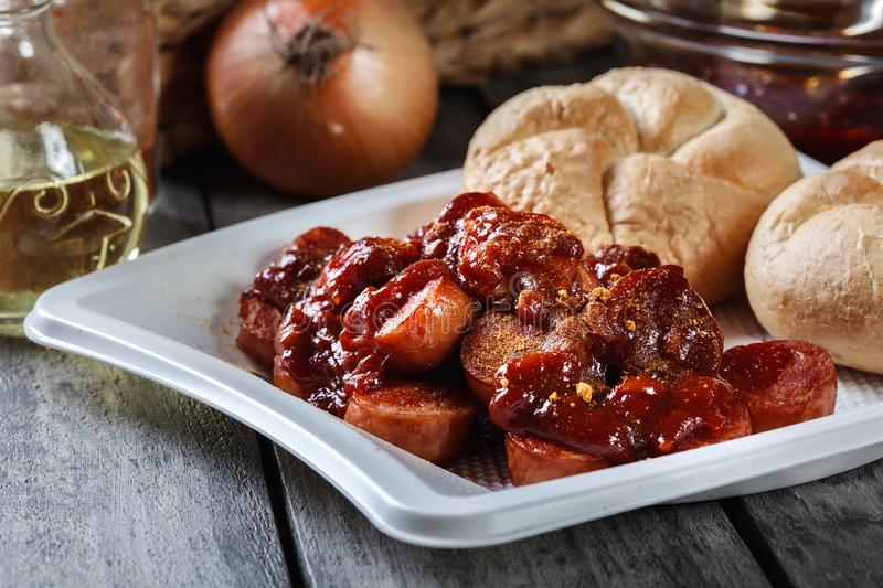 Delicious German currywurst - pieces of sausage with curry sauce stock photography