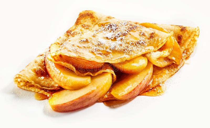 Delicious golden crepe with fresh apple filling stock photo