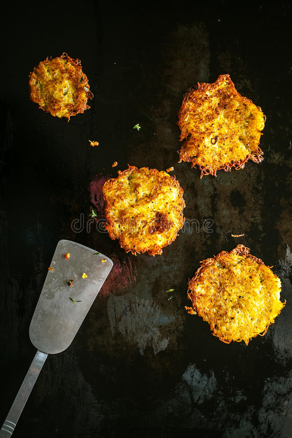 Delicious golden fried potato fritters stock images