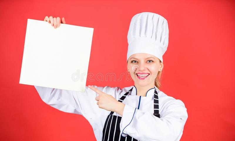 Delicious and gourmet. Chef author culinary book. Cooking food and culinary as hobby. Cook looking for cooking recipe in. Cookbook. Woman reading cook book in royalty free stock photography