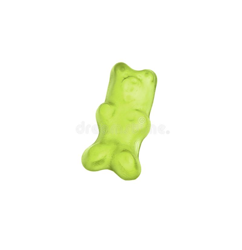Delicious green jelly bear on white. Background stock photography
