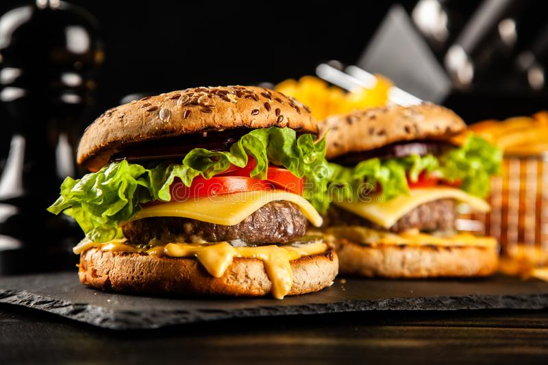 Delicious grilled burgers stock photos