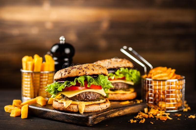 Delicious grilled burgers royalty free stock photography