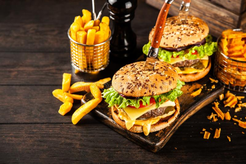 Delicious grilled burgers stock images