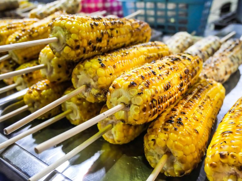 Grilled corns on the grille over fire at night market stock photo