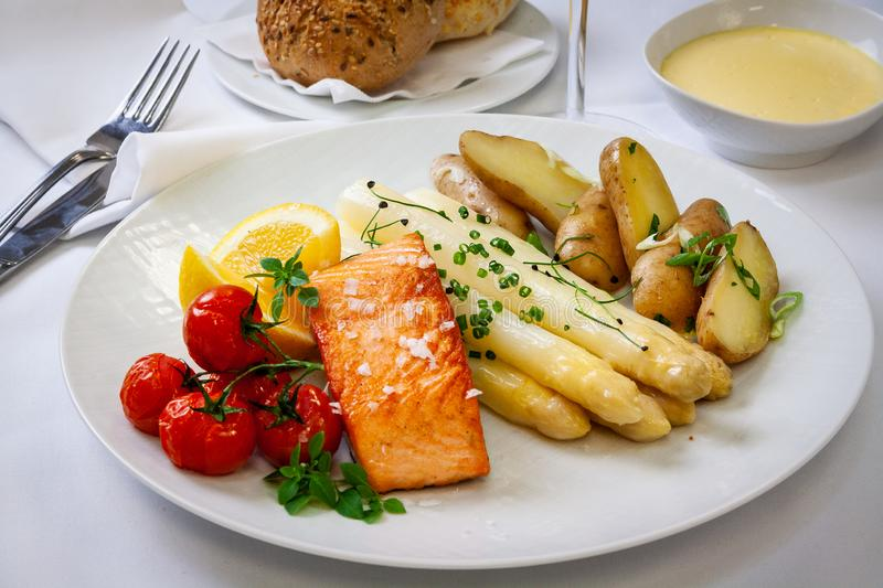 Delicious grilled filet of salmon with white asparagus royalty free stock photo