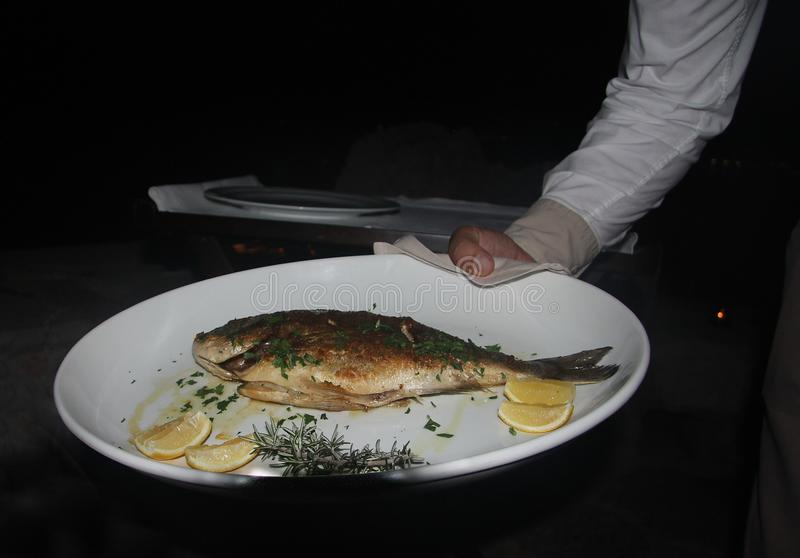 Delicious grilled fish in a restaurant in Montenegro stock photo