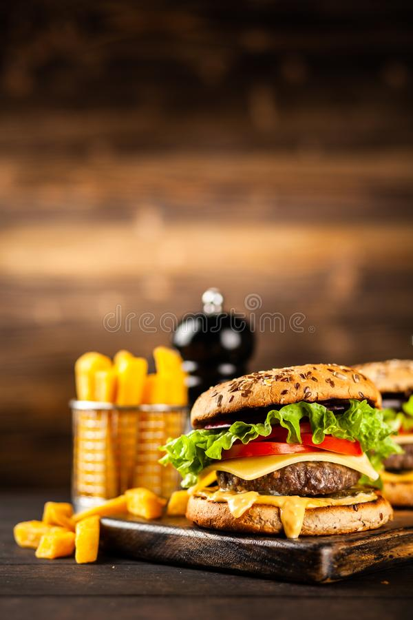 Delicious grilled burgers royalty free stock images