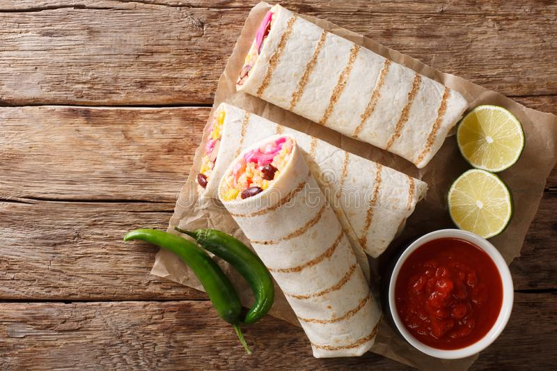 Delicious grilled mexican vegan burrito with rice, beans, corn, royalty free stock photography