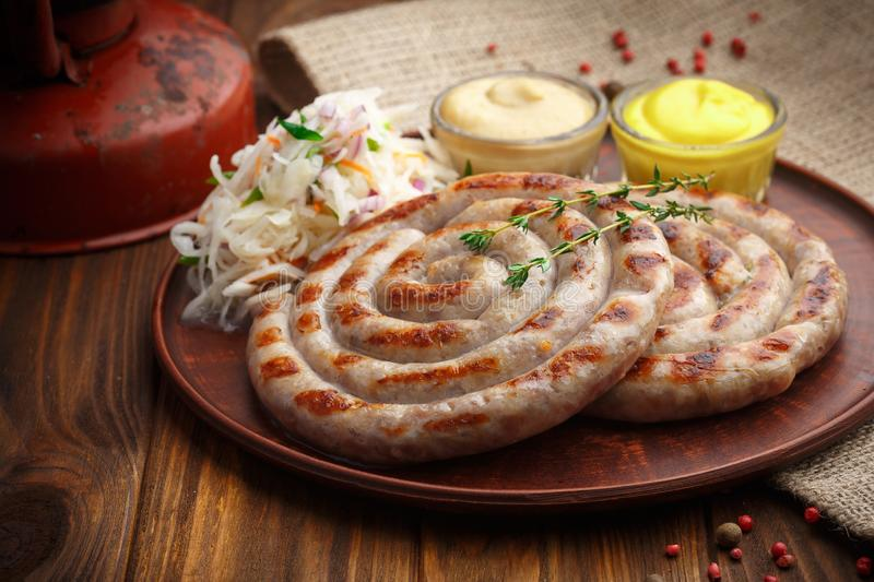 Delicious grilled sausages with a spicy basting sauce stock photos