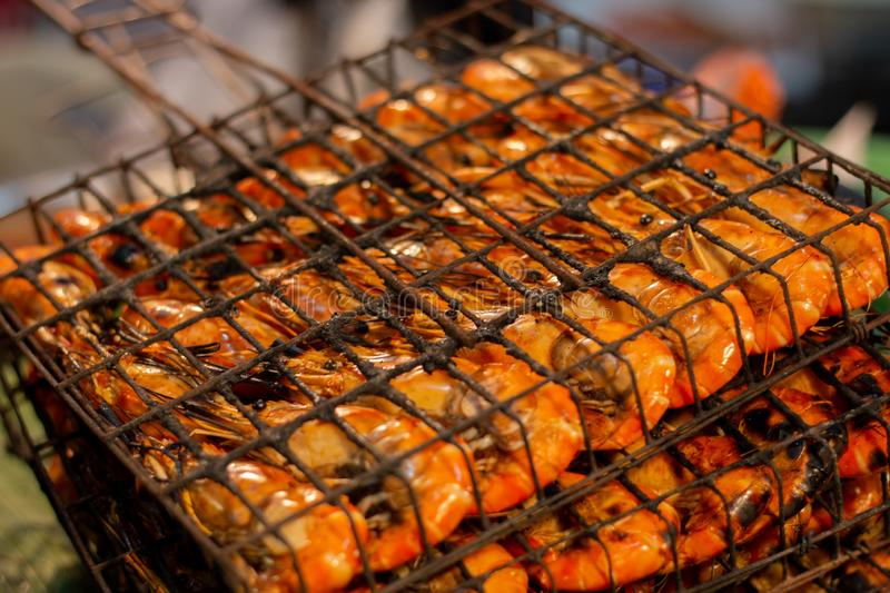 Delicious Grilled Shrimps. In the market for sale to customer royalty free stock photography