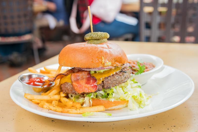 Delicious half pound steak burger, ate at the beautiful and hist stock photography
