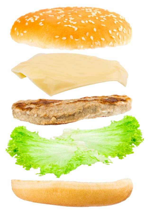 Delicious hamburger with flying ingredients on white background royalty free stock photo