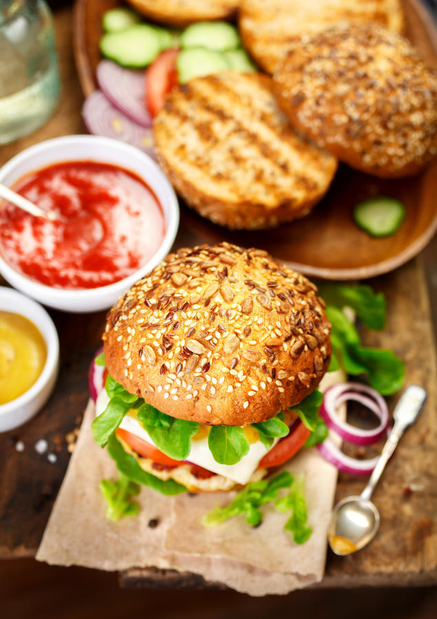 Delicious hamburger in rustic setting. royalty free stock photography