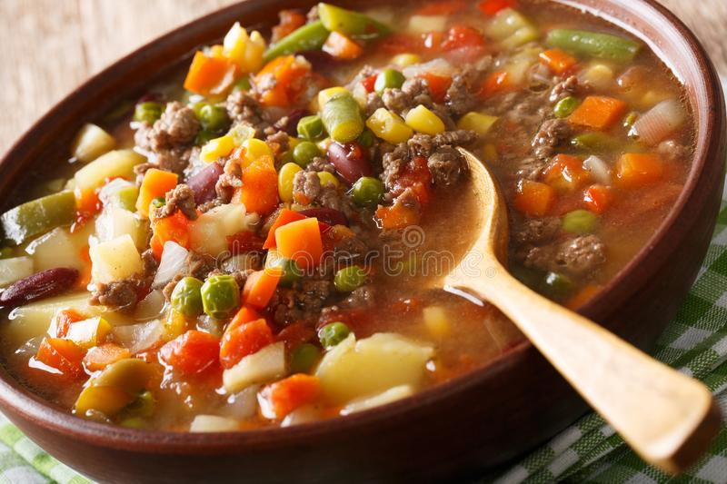 Delicious hamburger soup with ground beef and mix of vegetables. Close-up in a bowl on the table. horizontal stock images