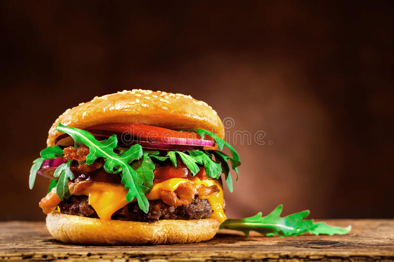 Delicious hamburger on wooden table royalty free stock photos