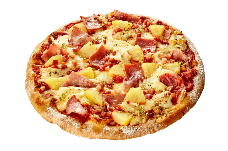 Delicious Hawaiian pizza with ham and pineapple. On a thick pastry crust flame grilled in a pizzeria isolated on white stock image