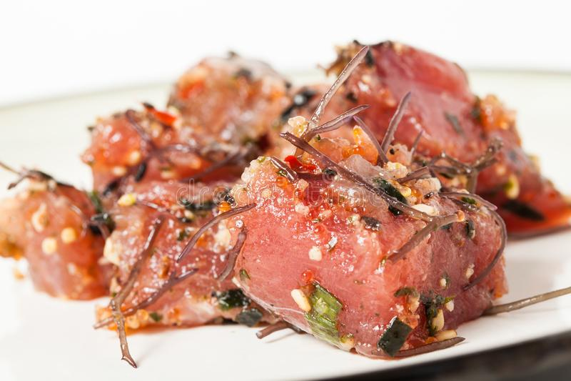 Delicious Hawaiian Poke Raw Fish Prepared with Onions and Seaweed royalty free stock photos