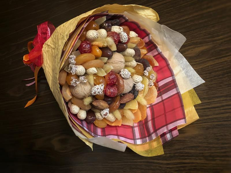 Delicious and healthy bouquet, composition of dried fruits and nuts, excellent gift for all occasions, concept of royalty free stock image