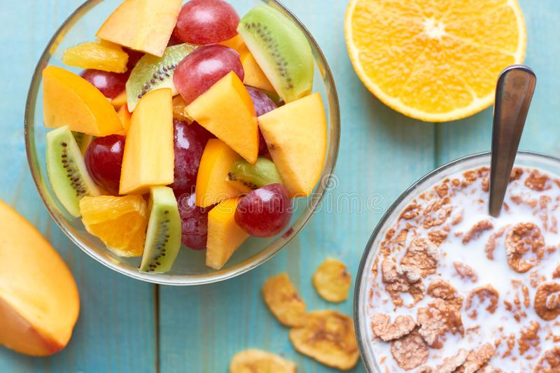 Delicious and healthy breakfast for the whole family. Corn flakes and fruit salad royalty free stock images