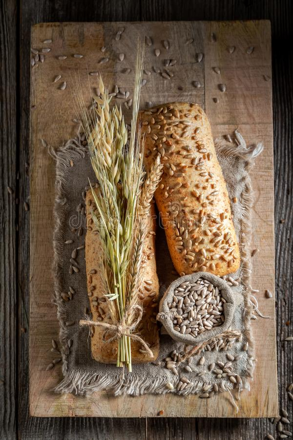 Delicious and healthy buns with wheat and ears stock image