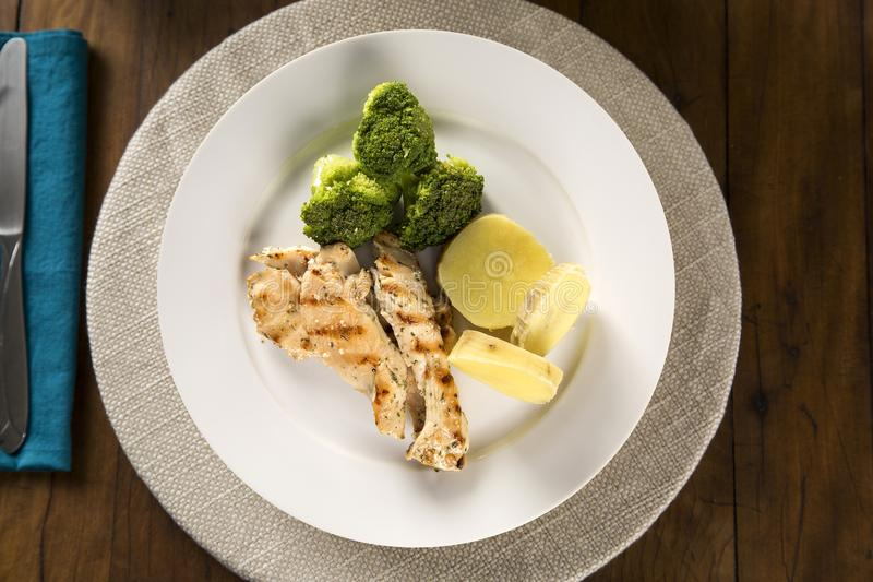 Delicious healthy food with grilled chicken and vegetables on the plate. View from the top.  stock images