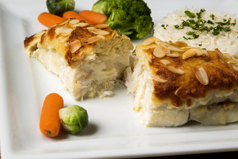 Delicious healthy grilled fish fillet served on a platter with a royalty free stock photo