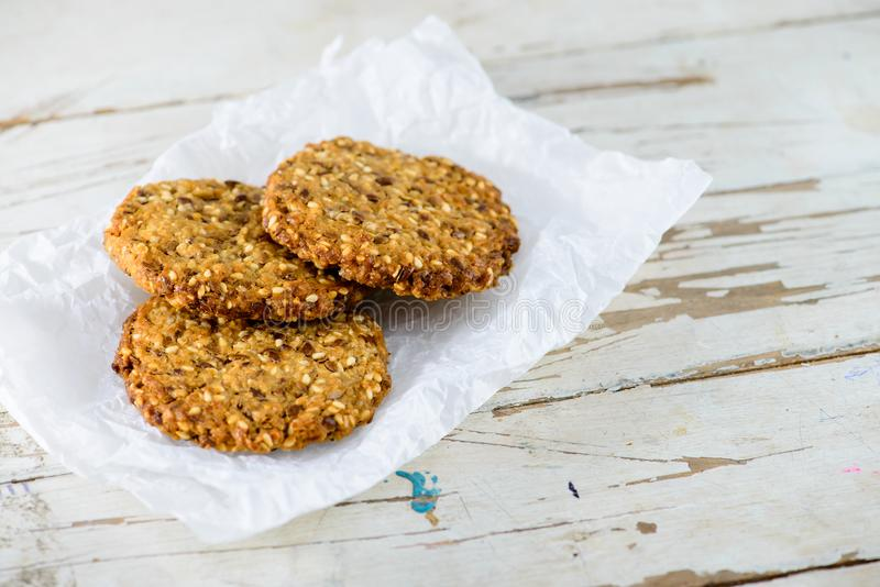 Delicious healthy oatmeal cookies with lime on the wooden backgr. Ound. Vegan food royalty free stock photo
