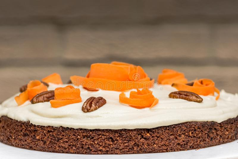 Delicious and healthy Vegan Carrot cake against isolated background, happy birthday stock photo