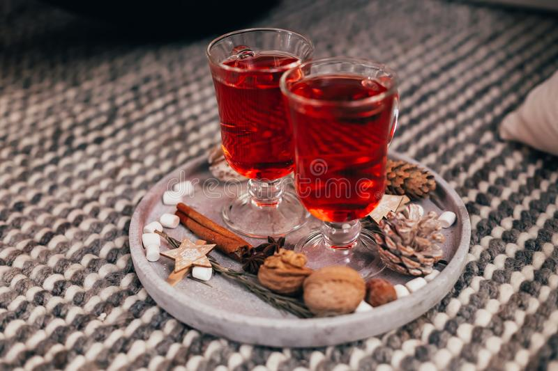 Delicious herbal red tea on a beautiful tray with Christmas decor stock images