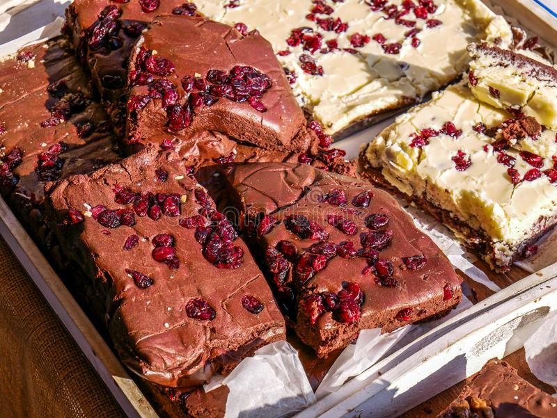 Delicious home baked brown and white chocolate bars with pomegranate seeds. Close up shot at the local fair royalty free stock images