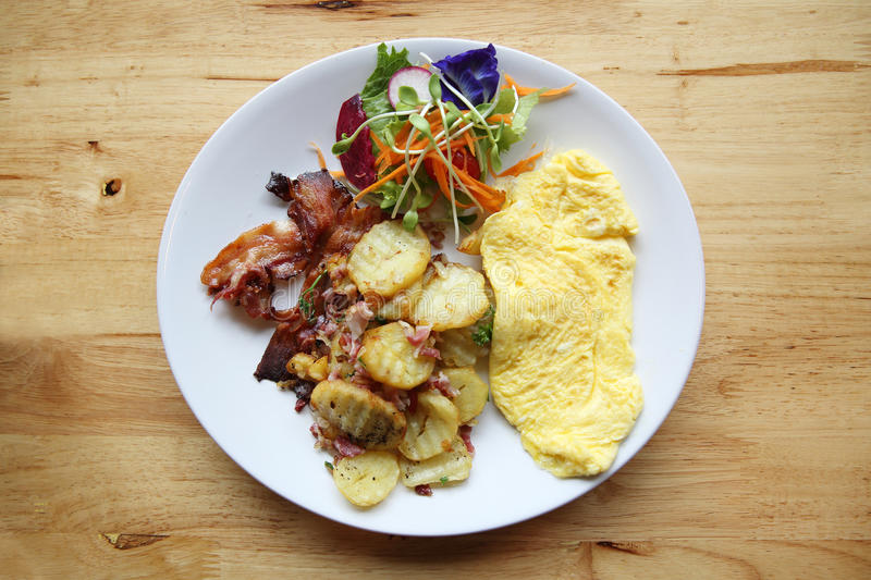 A delicious home style breakfast with crispy bacon, eggs omelette stock photo