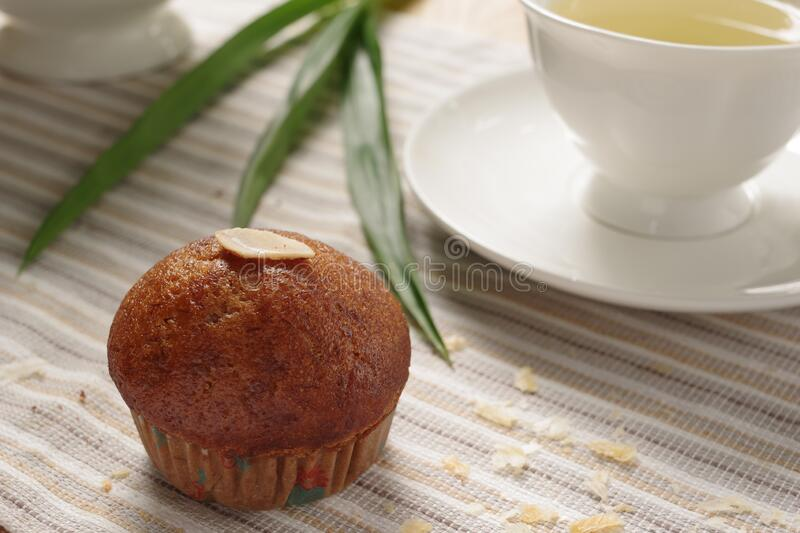 Tasty homemade banana muffin with earl grey in afternoon tea. royalty free stock photo