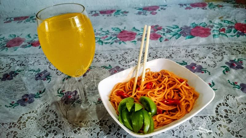 Delicious Homemade. Cheese bologneese spaghetti and florida orange royalty free stock image