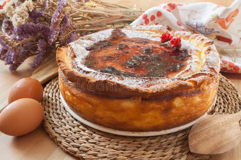 Homemade cheese cake with strawberry jam. Delicious homemade cheese cake with strawberry jam stock photography
