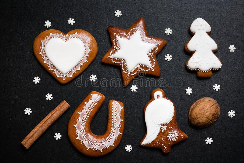 Delicious homemade Christmas gingerbread cookies on black background royalty free stock image
